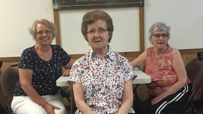 Cold Spring American Legion Post 455 Auxiliary members Norma Tramm, left, Evie Decker, center, and Judy Samuelson are veterans of the hamburger sale the auxiliary puts on as part of Cold Spring's Hometown Pride Days festival, which is scheduled for Friday and Saturday.
