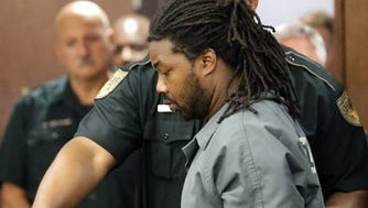 Jesse Leroy Matthew, shown at an extradition hearing in Texas on Sept. 25, 2014, is accused of abduction with intent to defile a missing University of Virginia sophomore, Hannah Graham, in Charlottesville, Va.