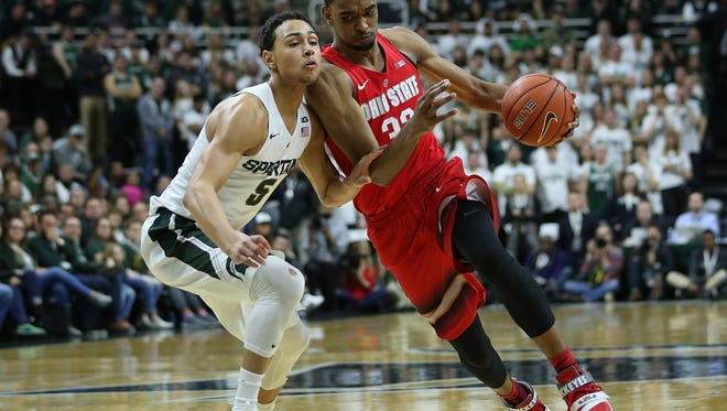 Keita Bates-Diop drives the ball to the basket as Bryn Forbes defends  during the second half of the game on March 5, 2016 at the Breslin Center in East Lansing, Michigan.