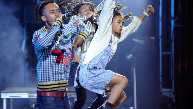 Jaden Smith, right, bounces onstage with Rae Sremmurd at Coachella.