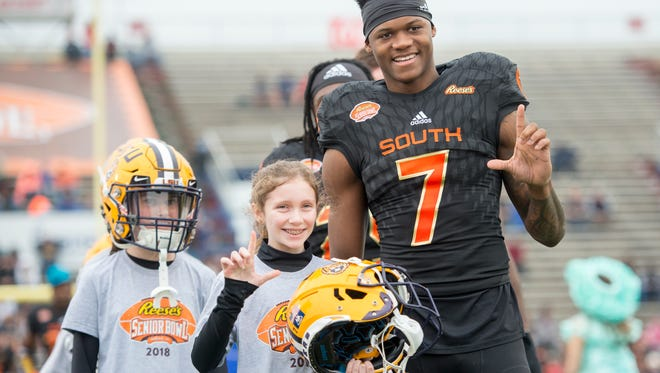Players are escorted by children from Special Spectators, Boys & Girls Clubs, and Big Brothers/Big Sisters during introductions prior the Senior Bowl in Mobile, Alabama on Saturday, January 27, 2018.