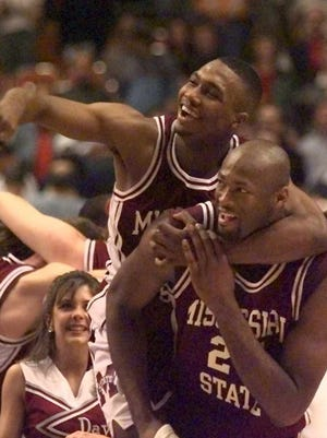 Mississippi State's Darryl Wilson (shown here riding on the back of teammate Erick Dampier after they beat Cincinnati 73-63 in the NCAA Southeast Regional final on March 24, 1996) will take over as the Itawamba AHS girls and boys basketball coach.