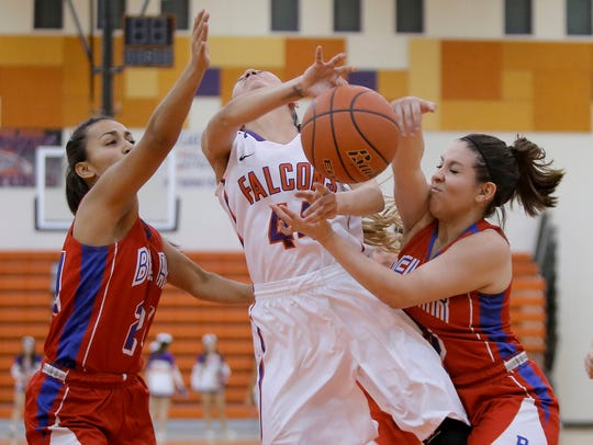 Eastlake's Alexia Gonzalez has the ball slapped away
