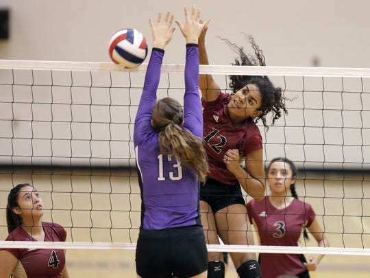 El Dorado's Victoria Pearson hits while being defended by Franklin's Andrea Alcantar Tuesday night at El Dorado High School. Franklin beat El Dorado in straight sets.