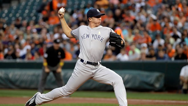 New York Yankees starting pitcher Chad Green throws to the Baltimore Orioles during the first inning of a baseball game in Baltimore, Friday, Sept. 2, 2016.
