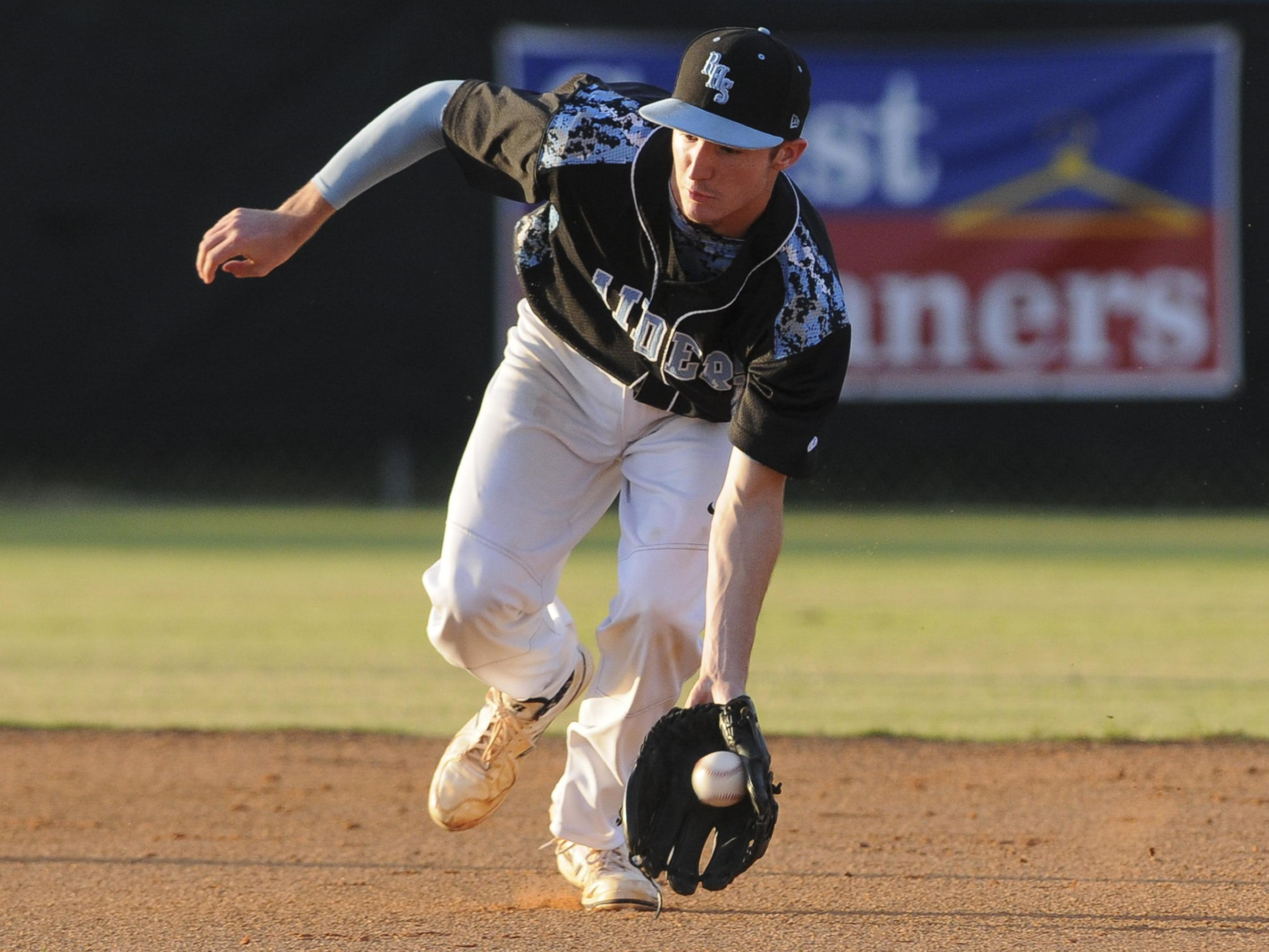 Austin Dennis fields a grounder during the 2015 Rockledge High baseball season.