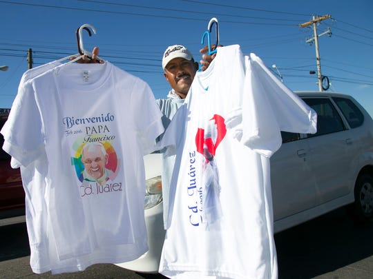 A man sells Pope Francis T-shirts in Juarez, Mexico,