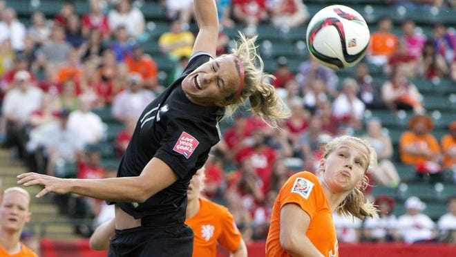 The Netherlands' Vivianne Miedema (9) and New Zealand's Hannah Wilkinson (17) battle for the ball a FIFA Women's World Cup game in Edmonton, Alberta, Canada, on Saturday. Wilkinson, a senior at Tennessee, is among several current U.S. college players who are playing for other nations in the World Cup.