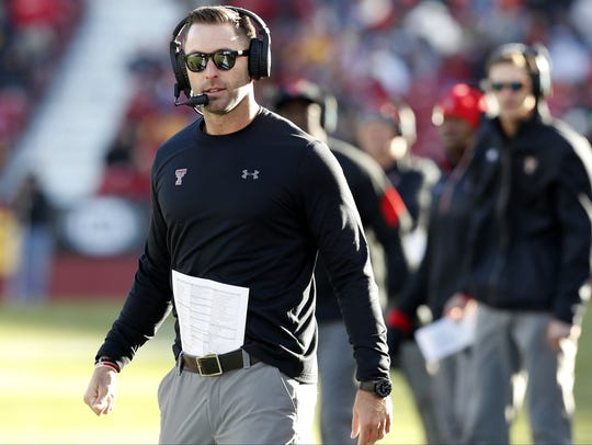Texas Tech head coach Kliff Kingsbury stands on the