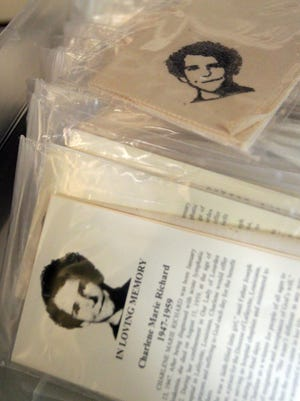 """Prayer cloths bearing the image of Charlene Richard, also known by many as the """"Little Cajun Saint,"""" are available for congregants and guests Tuesday, July 29, 2014, at St. Edward Catholic Church in the community of Richard, La."""
