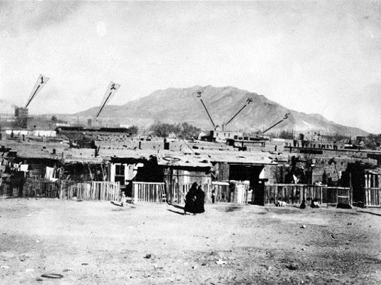 "Circa 1913. Looking north over ""Chihuahuita,"" from the U.S. Immigration Service Building at the Santa Fe Street Bridge. Unpaved area in foreground is Tenth Street between South Sante Fe and South El Paso streets."
