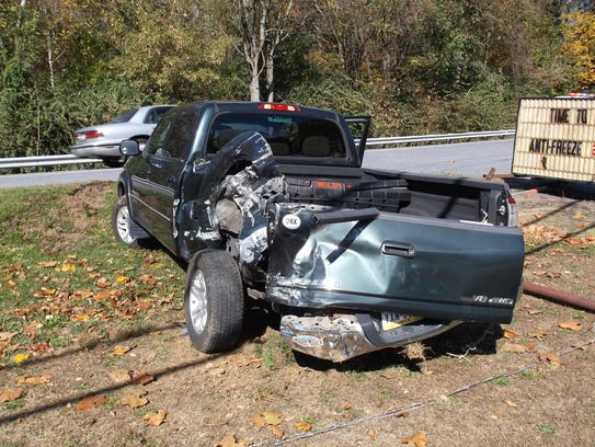 A Toyota Tundra pickup truck shows the damage it received