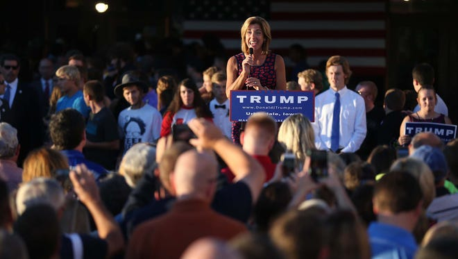 Tana Goertz, a member of Donald Trump's Iowa campaign staff and a former contestant on his show The Apprentice, introduces Trump to a crowd of people outside of Urbandale High School on Saturday, Sept. 19, 2015.
