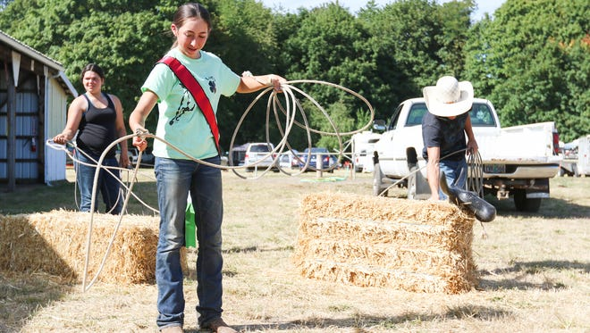 Lucy Desbiens of Dallas practices her roping skills at the Polk County Fair on Friday, Aug. 12, 2016. Desbiens qualified for equestrian events at the state fair.