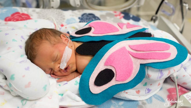 Families chose from about seven Halloween costume options at a Kansas City hospital.