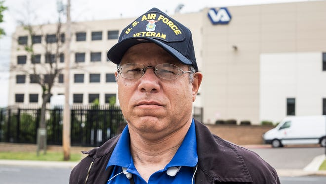 """Sean Higgins, United States Air Force Veteran and Memphis VA Medical Center whistle blower, stands outside of the Memphis VA Medical Center building on Jefferson. """"I'm here because I'm a veteran and that could be me in that building,"""" Higgins said."""