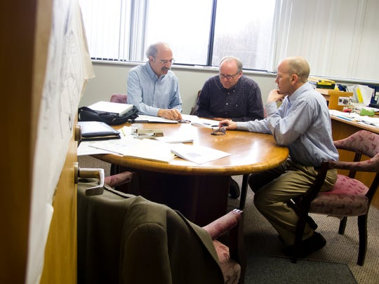 At the Burlington McNeil power station, plant manager John Irving, center, discusses a proposal for district heat with fellow-advocate Jan Schultz, left, and Michael Ahern, a consultant from St. Paul, Minn.-based Ever-Green Energy.