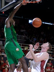 Oregon's Jordan Bell, left, dunks over Stanford's Grant Verhoeven during the first half of an NCAA college basketball game in Stanford, Calif., Saturday, Feb. 13, 2016. Stanford won 76-72.