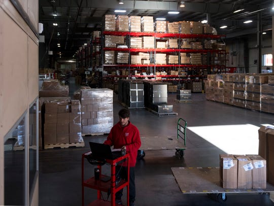 Kevin Guinn records all incoming shipments at the Red