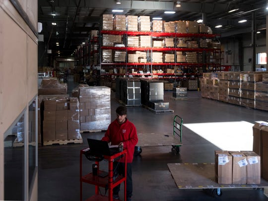 Kevin Guinn records all incoming shipments at the Red Stag Fulfillment on Wednesday, January 10, 2018.