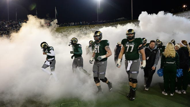 CSU players take the field for the start of the second half of a Nov. 18 game at Hughes Stadium against New Mexico. That was one of five Mountain West games the Rams played last season that began at 8 p.m. or later to accommodate national TV broadcasts.