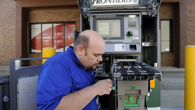Peter Severin, a service technician for Case Financial, does maintenance on the interactive teller machine at Frontier Bank in Rock Rapids, Iowa, on Aug. 12. Frontier Bank also has ITMs in Little Rock, Iowa, Sioux Falls at 57th and also in the downtown Sioux Falls location.
