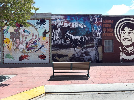 Murals on the wall of a residence at 300 Chihuahua