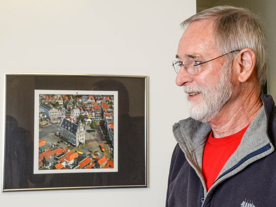 Ron Lubsen keeps framed photos, including one of the