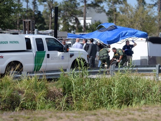 Homeland Security agents raid the TentLogix business on Wednesday, March 28, 2018, in Fort Pierce.