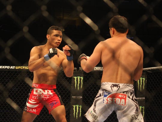 In this file photo, Jon Tuck and Tae Hyun Bang feel each other out during the first moments of their fight at UFC Fight Night 66 in Manila at SM Mall of Asia. Tuck won via submission, rear naked choke.