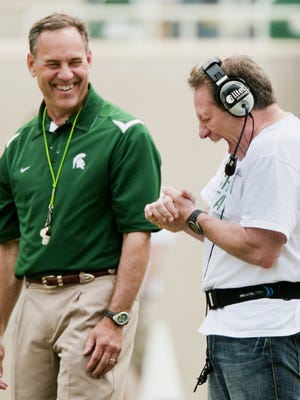 MSU Men's Basketball Head Coach Tom Izzo (right) shares a laugh with MSU Football Head Coach Mark Dantonio during the MSU Green and White Spring game Saturday April 25, 2009 in East Lansing.  Izzo took the field and wore the head coach's headset for a brief time during the game.  KEVIN W. FOWLER PHOTO  Photo Gallery