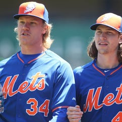 May 23, 2015; Pittsburgh, PA, USA;  New York Mets starting pitchers Noah Syndergaard (34) and Jacob deGrom (48) before playing the Pittsburgh Pirates at PNC Park. Mandatory Credit: Charles LeClaire-USA TODAY Sports ORG XMIT: USATSI-214638 ORIG FILE ID:  20150523_gav_al8_004.jpg