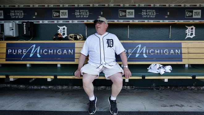 After signing a one-day contract with the Detroit Tigers, Earl Robinette, 80, enjoys a moment in the Tigers' dugout Wednesday, May 25, 2016 at Comerica Park.