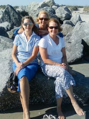 Diane, Kathyrn and Jaine on the seashore together.