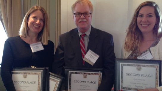 That's Clare Becker, left, and Lily Reed, right, award