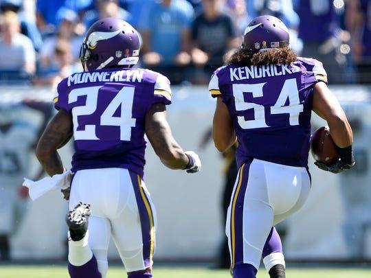 Vikings middle linebacker Eric Kendricks (54) runs back his interception with Vikings cornerback Captain Munnerlyn (24) for a TD in the third quarter Sunday.