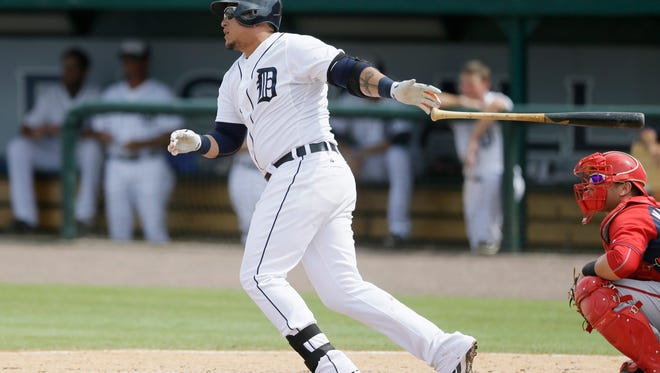 Detroit Tigers' Miguel Cabrera singles to left field during the sixth inning of a spring training exhibition baseball game against the Washington Nationals in Lakeland, Fla., Sunday, March 22, 2015.