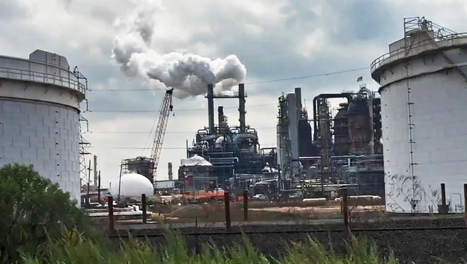 New Jersey reached a settlement with Exxon for $225 million to compensate for decades of wetlands pollution around the company's refineries in Linden and Bayonne.