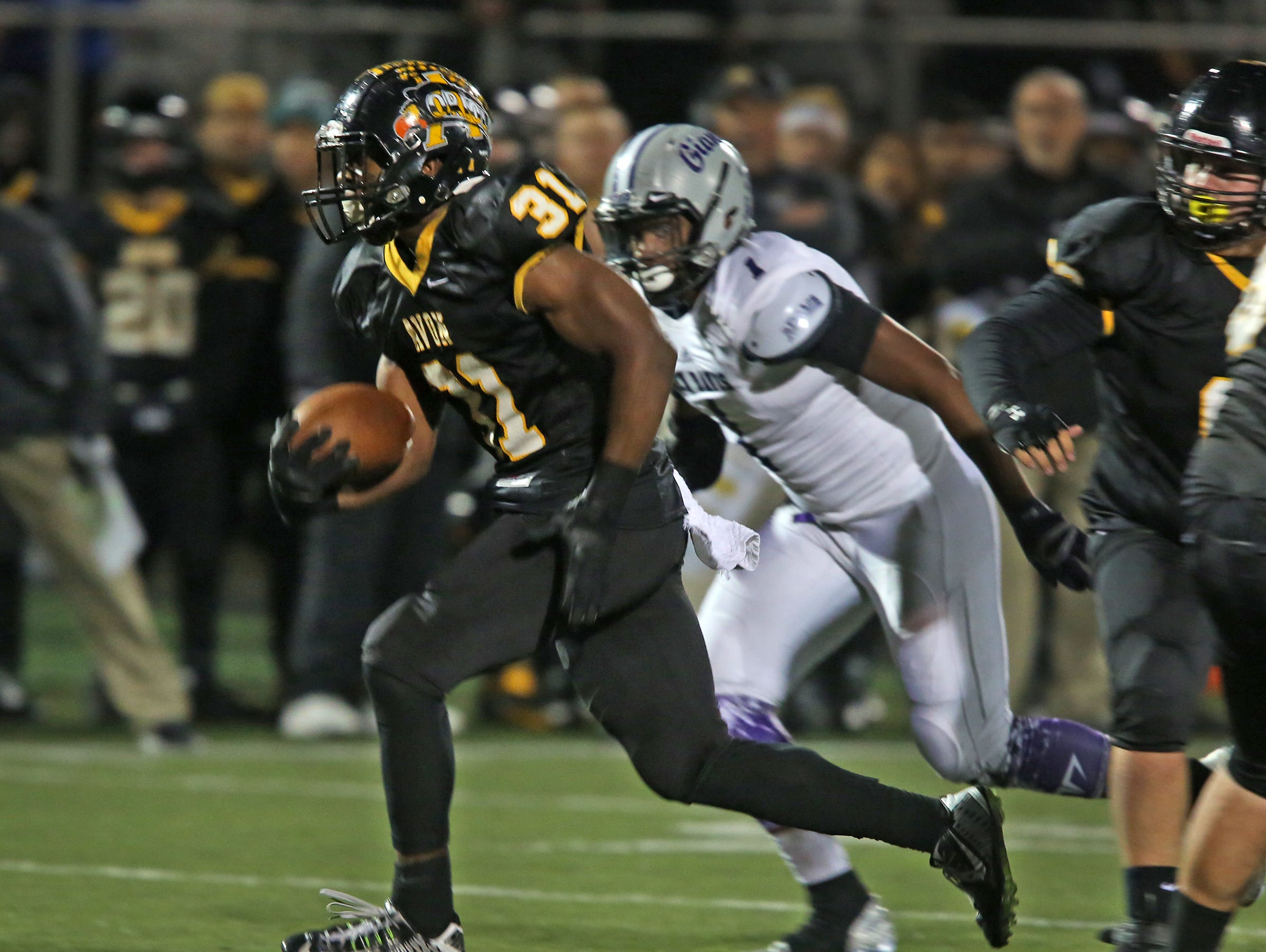 Avon's Bryant Fitzgerald takes off for a touchdown in sectional action against Ben Davis, Oct. 30, 2015.