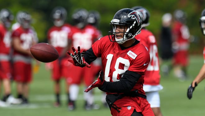 Wide receiver Jordan Leslie (18) catches a pass during a drill in Falcons training camp on July 28 in Flowery Branch, GA.