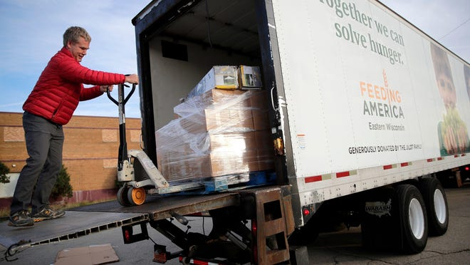 Jon St. Louis of Feeding America Eastern Wisconsin unloads a truck filled with food in Appleton on Oct. 19, 2017, before the start of the Stock the Shelves mobile pantry.