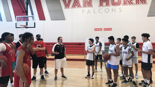 Van Horn boys basketball coach Max Sollars, center, speaks with his team and Truman's team during Friday's workout at Van Horn. Van Horn is hosting fellow Independence School District teams Truman and William Chrisman for summer workouts amid the coronavirus pandemic.