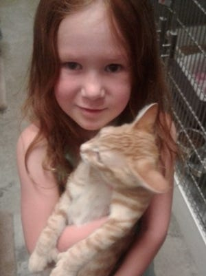 Cora Pogge and one of the cats from PurrFect Haven Cat Rescue