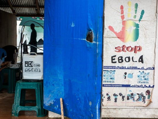 An Ebola prevention poster sits outside an Ebola Treatment