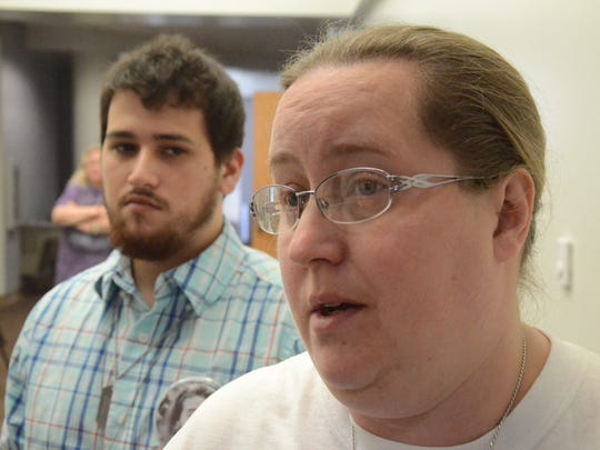 Lori Gauthier speaks about the death of her son, Robert Barroso as his brother, Jeremy listens Monday, Oct. 2, 2017.