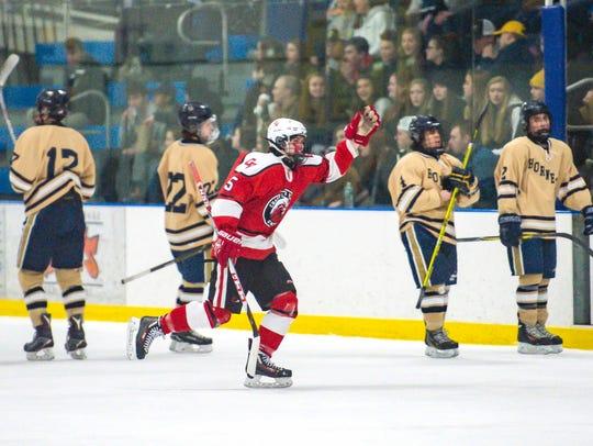 Champlain Valley Union's Jake Schaefer celebrates a
