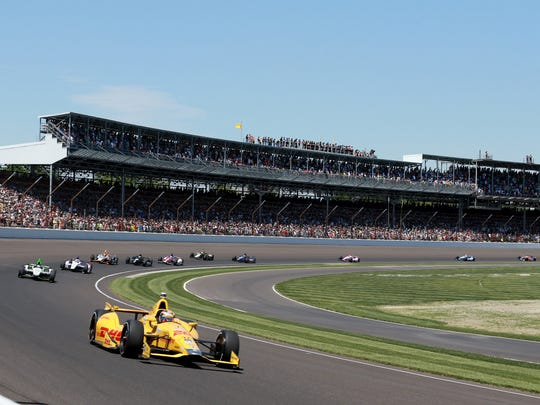 Ryan Hunter-Reay leads the race and later won the 98th running of the Indianapolis 500 at the Indianapolis Motor Speedway, May 25, 2014.