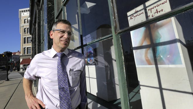 In this Nov. 14, photo, Mayor Chris Louras poses outside an exhibit featuring Syrian art in downtown Rutland.