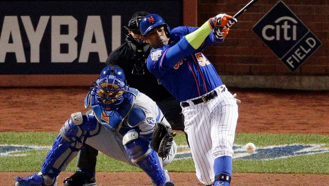 New York Mets' Yoenis Cespedes fouls a ball off his leg during the sixth inning of Game 5 of the Major League Baseball World Series against the Kansas City Royals Sunday, Nov. 1, 2015, in New York.