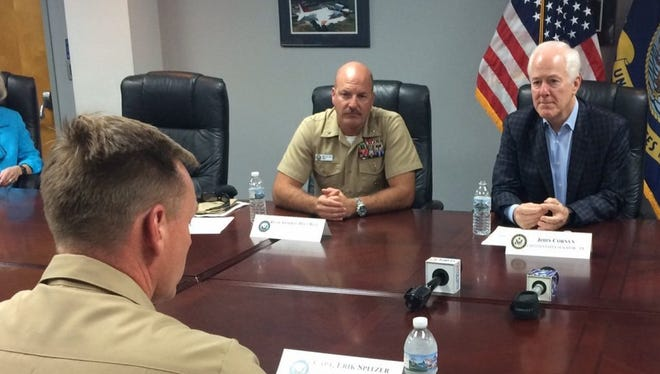 U.S. Sen. John Cornyn (far right) and Navy Rear Admiral Dell Bull (center) listen to concerns about wind turbines raised by Navy Capt. Erik Spitzer, commanding officer of NAS Kingsville. Cornyn introduced a bill last month that seeks to end tax credits for new wind farms that would be located within 30 miles of an active military airfield.